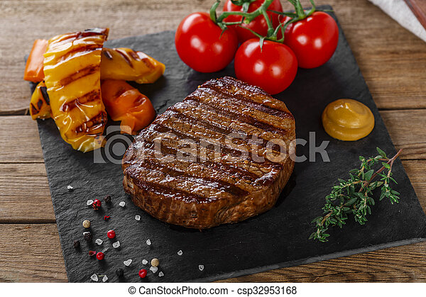 grilled beef steak with vegetables  - csp32953168
