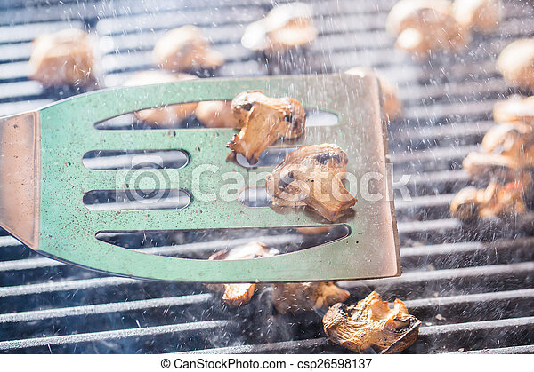 2f582cd97ef2 Grilled champignon mushrooms on spatula with steam and drops of water -  csp26598137