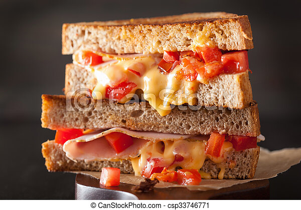 grilled cheese sandwich with ham and tomato - csp33746771