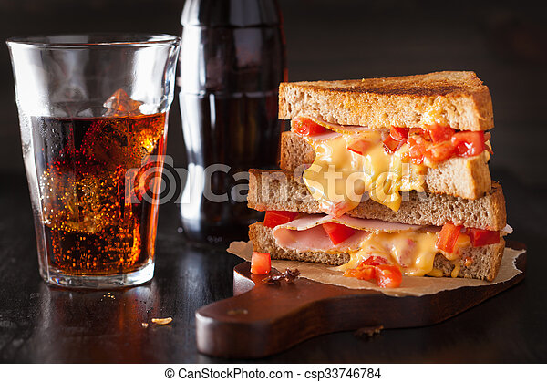 grilled cheese sandwich with ham and tomato - csp33746784