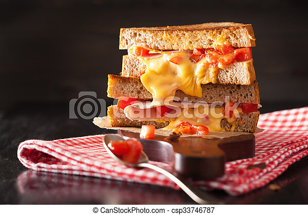 grilled cheese sandwich with ham and tomato - csp33746787