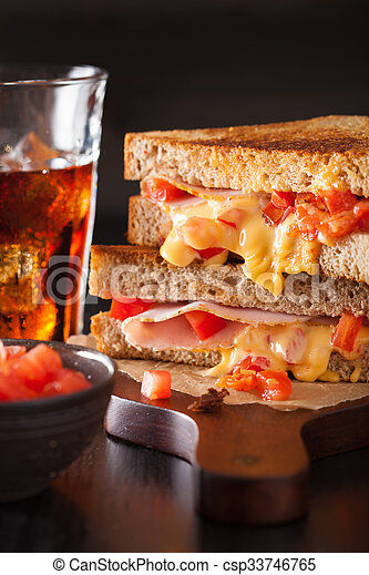 grilled cheese sandwich with ham and tomato - csp33746765