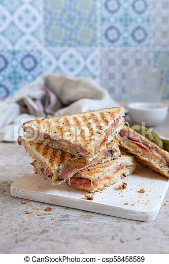 Grilled cheese sandwich with ham - csp58458589
