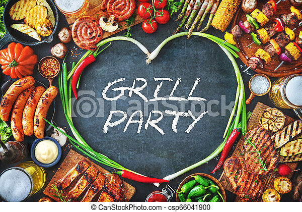 Grilled meat and vegetables on rustic stone plate - csp66041900