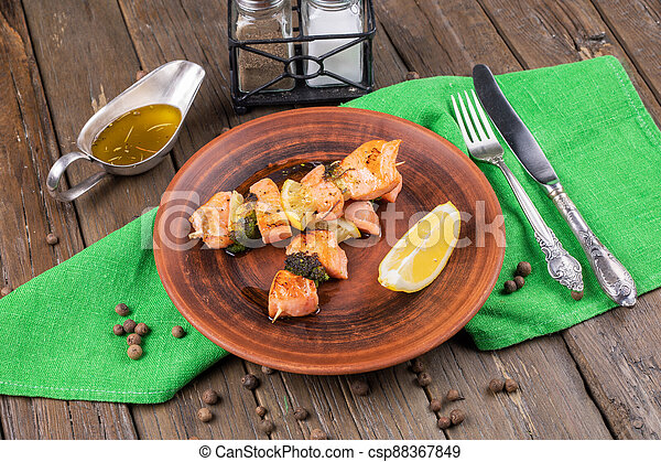 Grilled meat and vegetables on wooden background - csp88367849