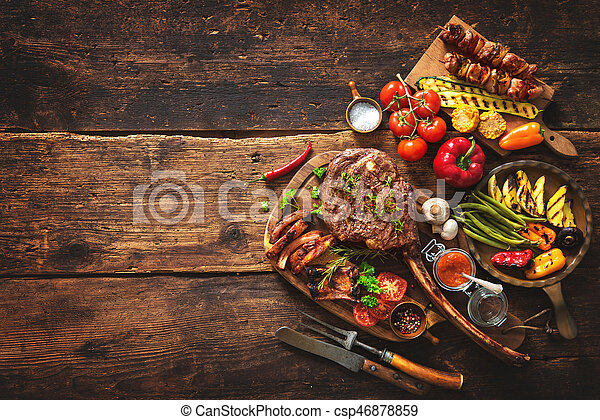 Grilled meat and vegetables - csp46878859