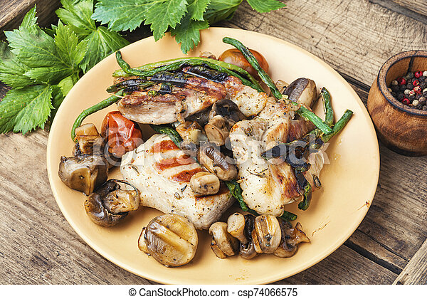 Grilled meat on rustic wooden table - csp74066575