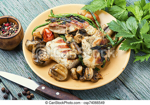Grilled meat on rustic wooden table - csp74066549
