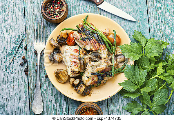 Grilled meat on rustic wooden table - csp74374735