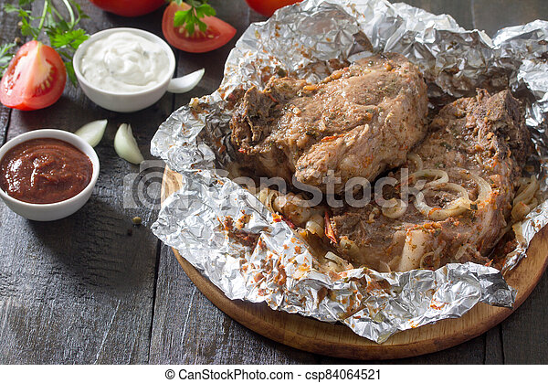 Grilled meat with sauce and vegetables on a dark rustic background, top view, frame. Food Concept Thanksgiving. - csp84064521