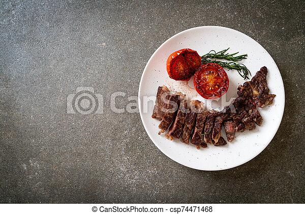 Grilled medium rare beef steak - csp74471468