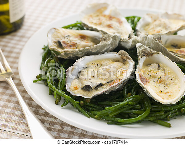 Grilled Oysters with Mornay Sauce on Samphire - csp1707414