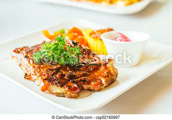 Grilled pork ribs with bbq sauce - csp52160697
