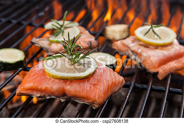 Grilled salmon steaks on fire - csp27608138