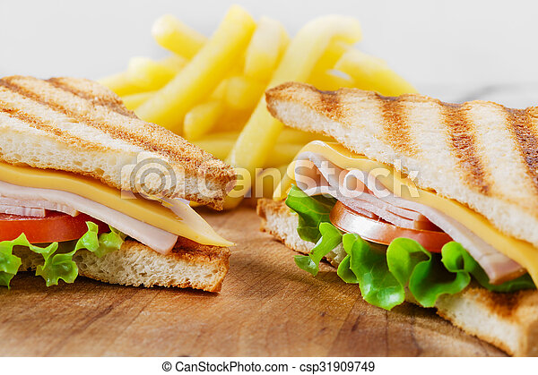 Grilled sandwich with ham cheese - csp31909749