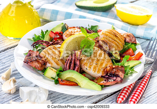 Grilled squids with vegetable on wooden background - csp42009333