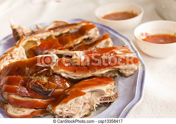 Grilled suckling pig on a plate - csp13358417