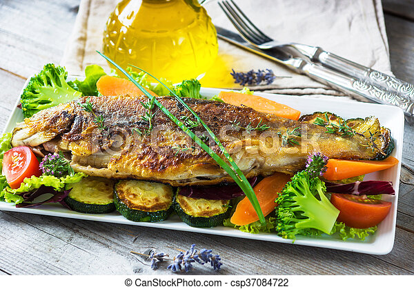 Grilled trout with vegetables on wooden background - csp37084722