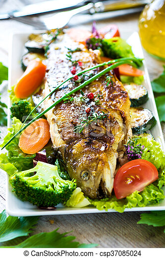 Grilled trout with vegetables on wooden background - csp37085024