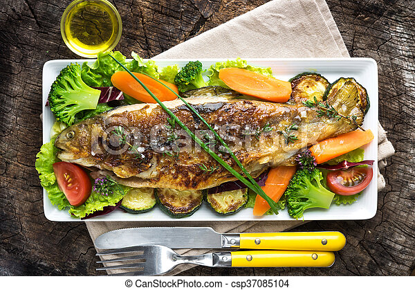 Grilled trout with vegetables on wooden background - csp37085104