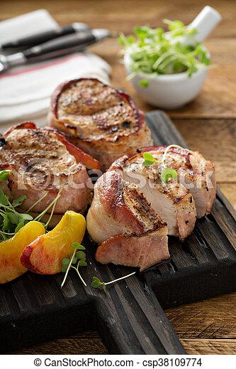 Grilled turkey tenderloins with bacon - csp38109774