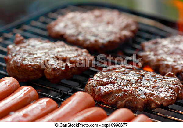 Grilling burgers and hot dogs  - csp10998677