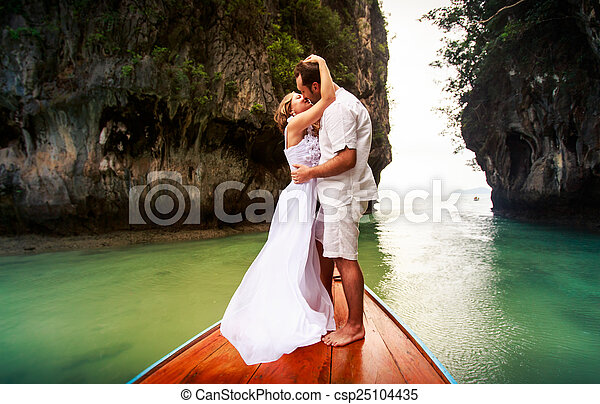 groom kissing and embracing bride - csp25104435