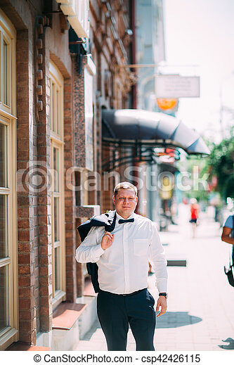 groom on the background of a city street - csp42426115