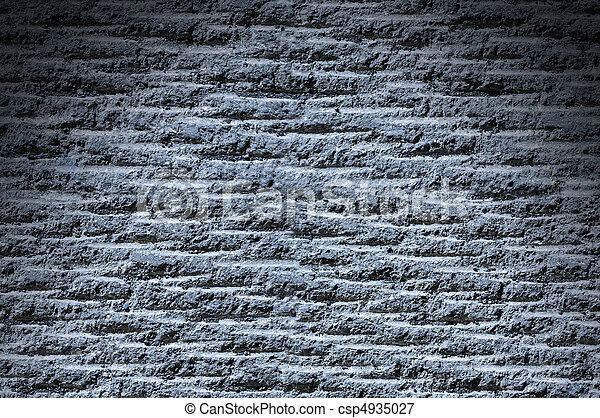 Grooved asphalt or rock surface texture lit from above with blue light - csp4935027