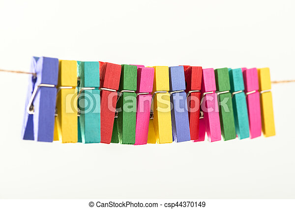Group colorful clothespin on white background - csp44370149