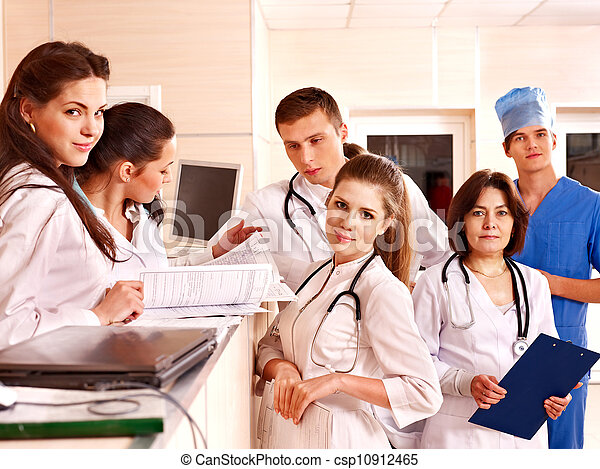 Group doctors at reception in hospital. - csp10912465