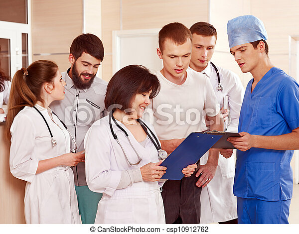 Group doctors at reception in hospital. - csp10912762