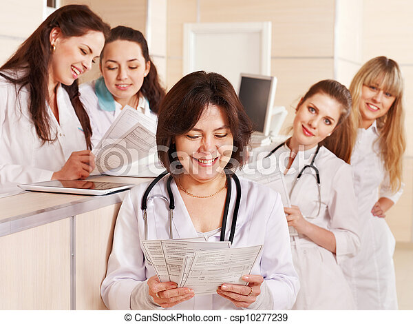 Group doctors at reception in hospital. - csp10277239
