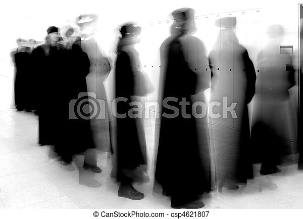group graduation of students entering university lecture hall (motion blurred shot) - csp4621807