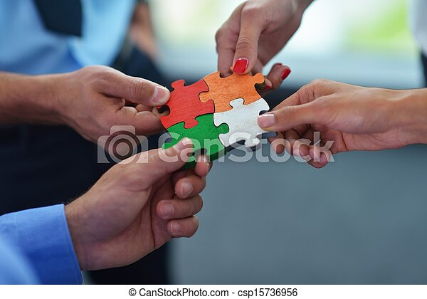 Group of business people assembling jigsaw puzzle - csp15736956