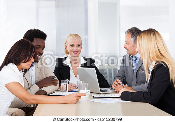 Group Of Businesspeople Discussing Together - csp15238799
