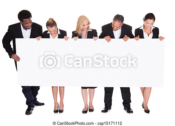 Group Of Businesspeople Holding Placard - csp15171112