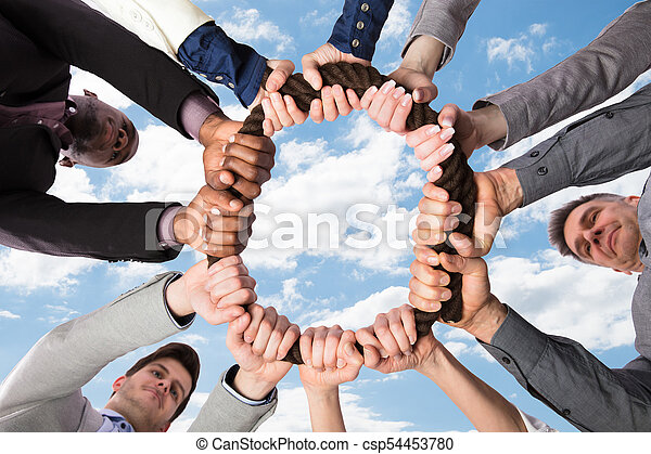 Group Of Businesspeople Holding Rope Together - csp54453780