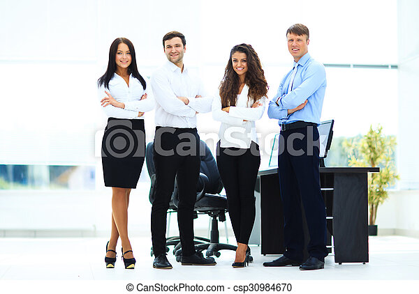 group of businesspeople standing together in office - csp30984670