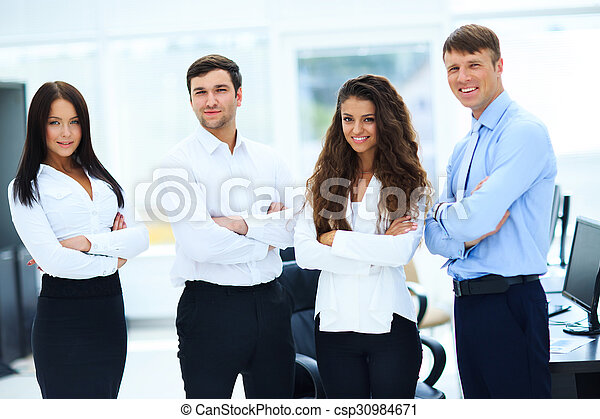 group of businesspeople standing together in office - csp30984671