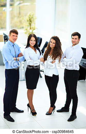 group of businesspeople standing together in office - csp30984645