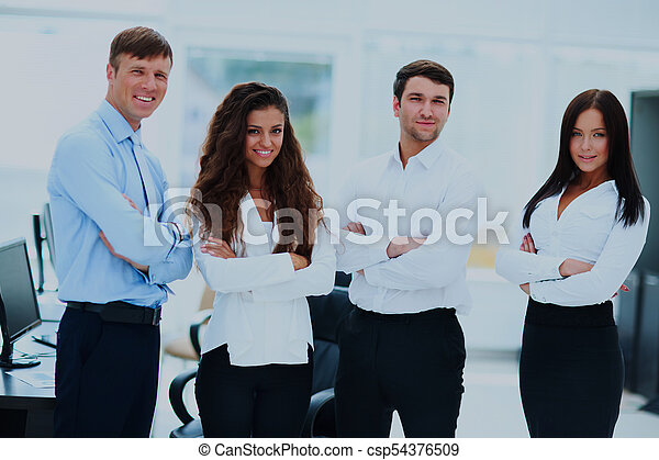 group of businesspeople standing together in office. - csp54376509