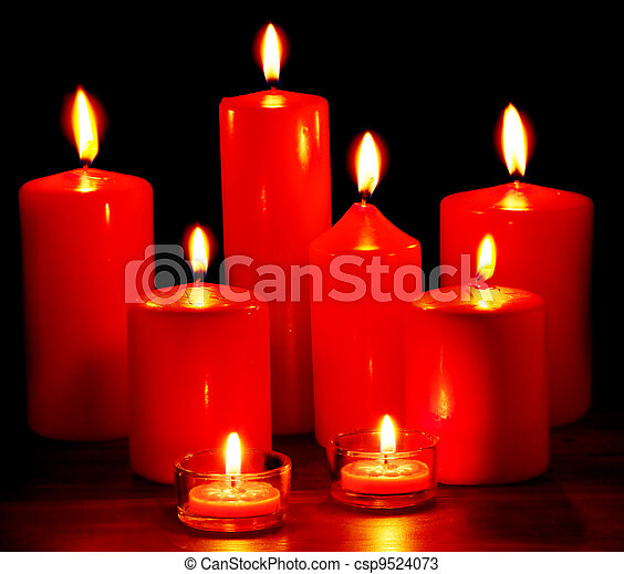 Group Of Candles On Black Background