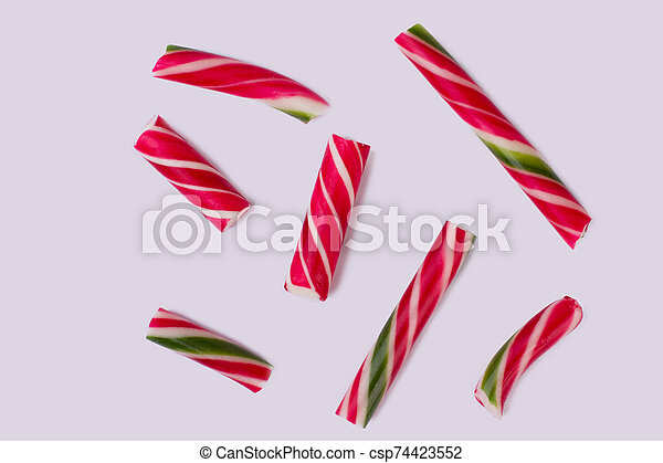 Group of candy canes on white background. - csp74423552