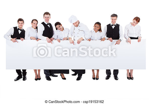 Group of catering staff holding a blank banner - csp19153162