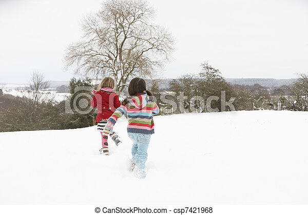 Group Of Children Having Fun In Snowy Countryside - csp7421968