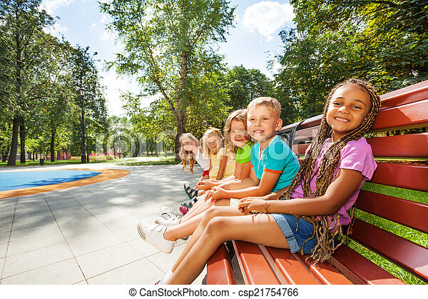 Group of children on the bench in park - csp21754766