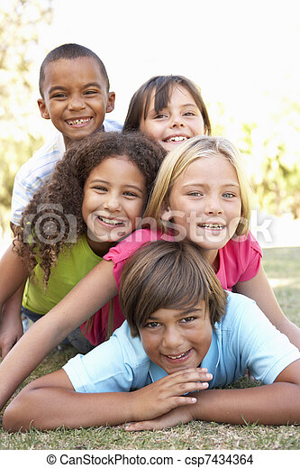 Group Of Children Piled Up In Park - csp7434364
