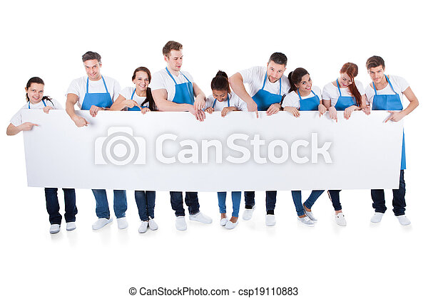 Group of cleaners holding a blank white banner - csp19110883
