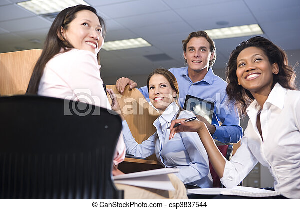 Group of college students studying together - csp3837544